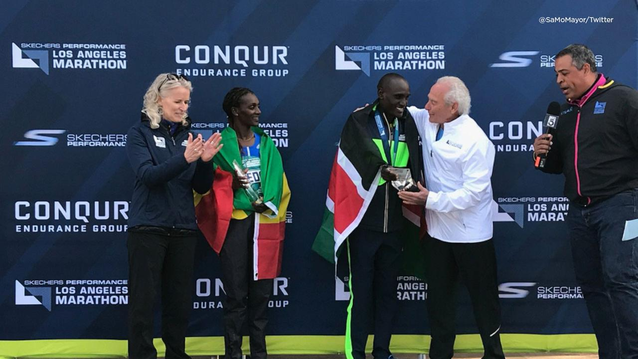 Awards are handed out to the 2018 Los Angeles Marathon mens and womens champions on Sunday, March 18, 2018.
