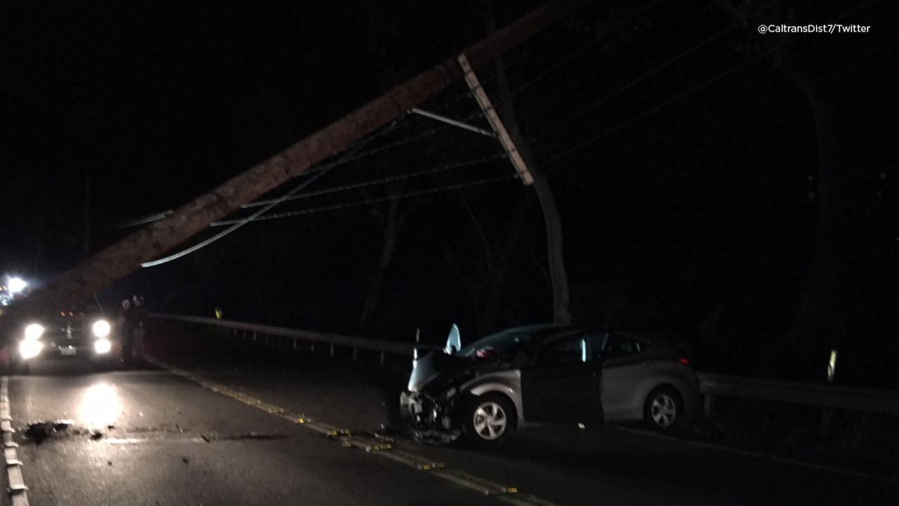 A power pole seen down along Topanga Canyon Boulevard after a vehicle crashed into it early Monday, March 19, 2018.
