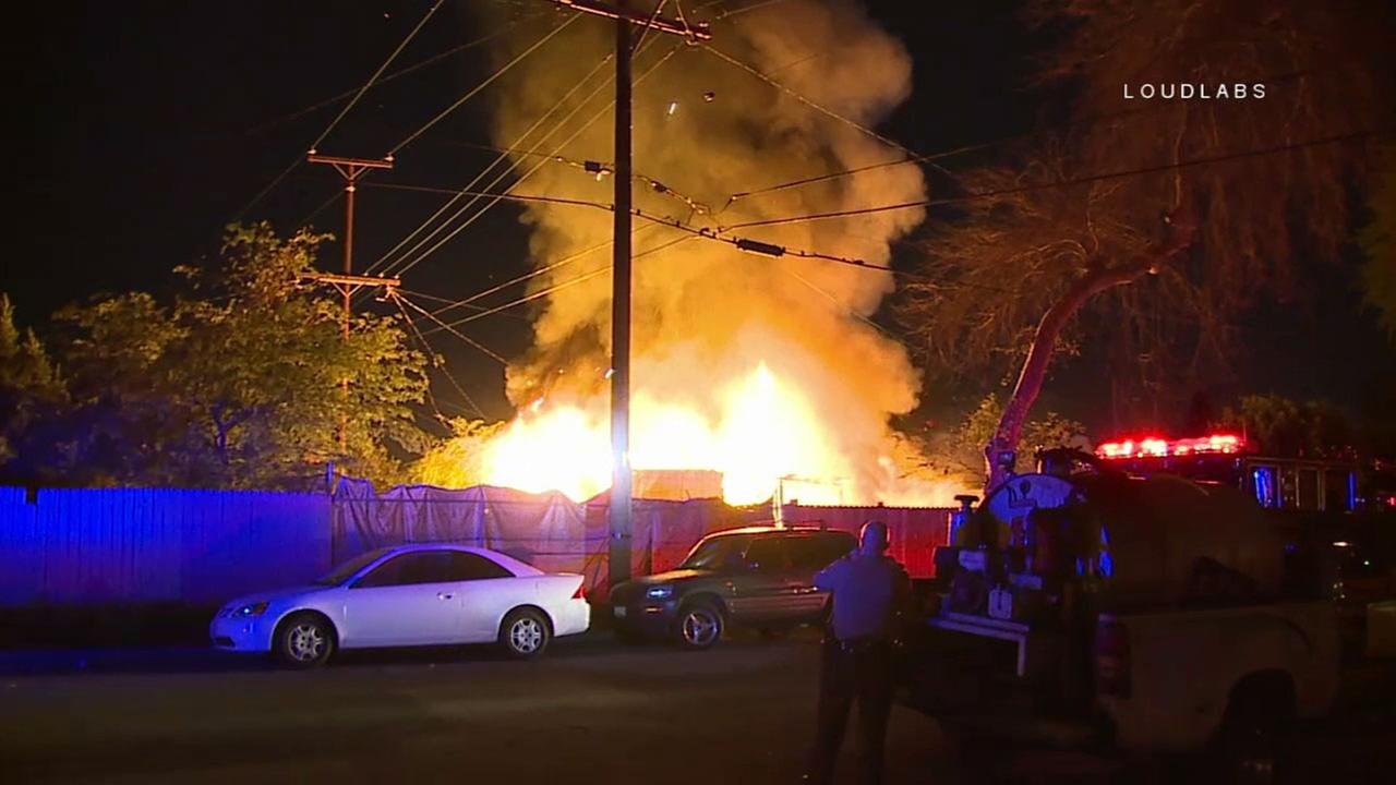 An explosive fire burns at a Compton structure early Monday, March 19, 2018.