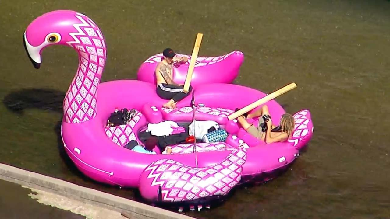 Three people were seen aboard a hot pink flamingo-shaped inflatable raft floating down the L.A. River on Monday, March 19, 2018.
