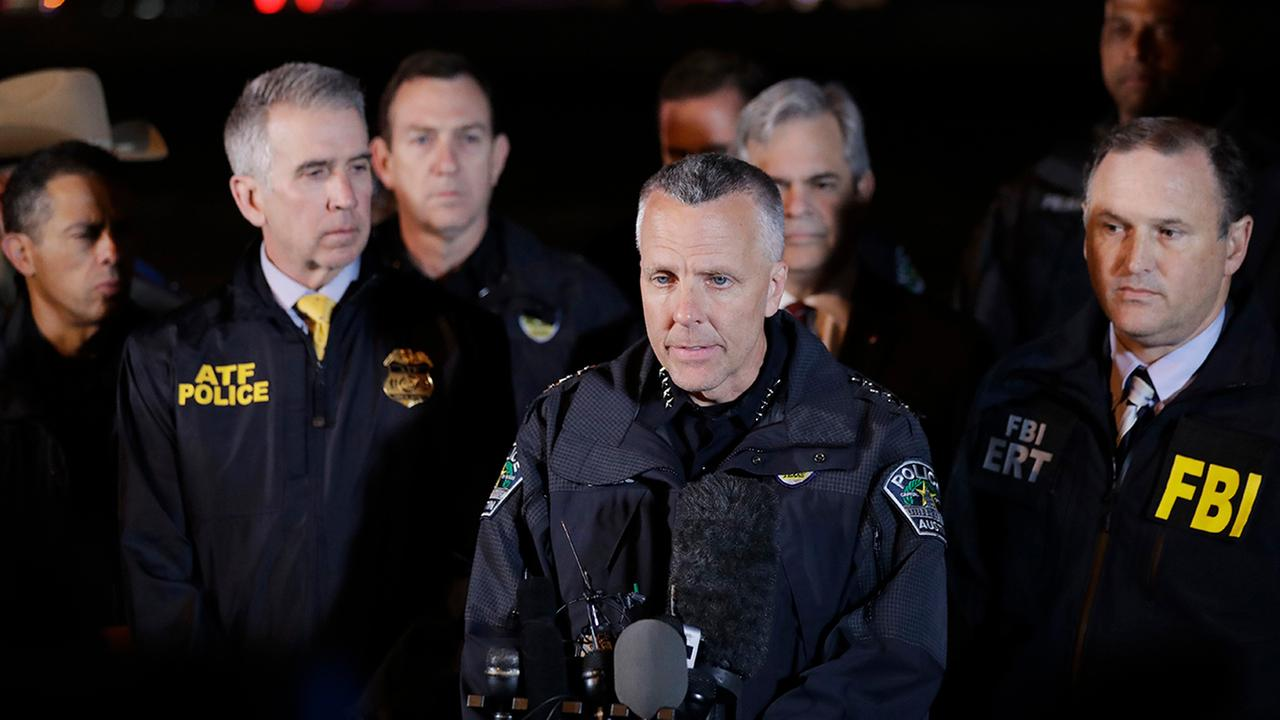 Austin Police Chief Brian Manley, center, stands with other members of law enforcement as he briefs the media, Wednesday, March 21, 2018, in the Austin suburb of Round Rock, Texas.