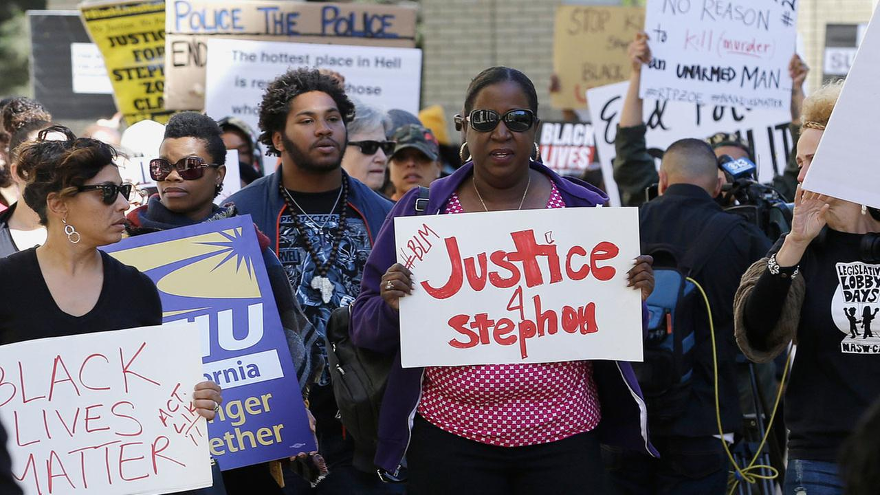 Protesters march past Sacramento City Hall in a demonstration, Thursday, March 22, 2018, over the shooting death of Stephon Alonzo Clark by two Sacramento Police officers.