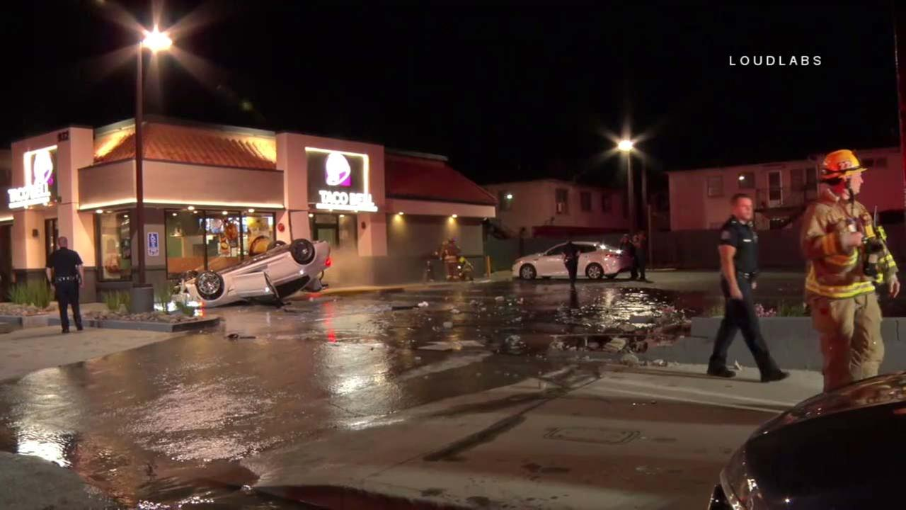 A car ended up on its roof after slamming into a Taco Bell restaurant in Glendale on Monday, March 26, 2018.