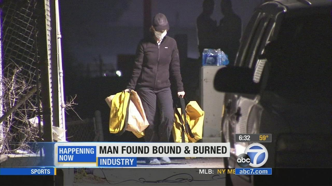 An investigation in underway after a man was found bound and burned on the 605 Freeway in Industry on Tuesday, April 15, 2014.