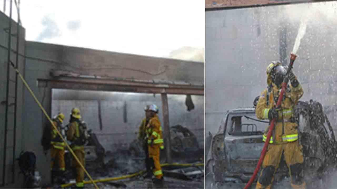 Pasadena firefighters respond to the scene of a fire at an auto body shop in the 800 block of South Arroyo Parkway Saturday, Sept. 27, 2014.