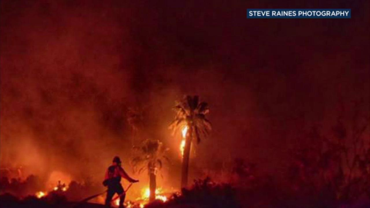 A photo shows a historical landmark in Joshua Tree National Park on fire in a suspected arson case.