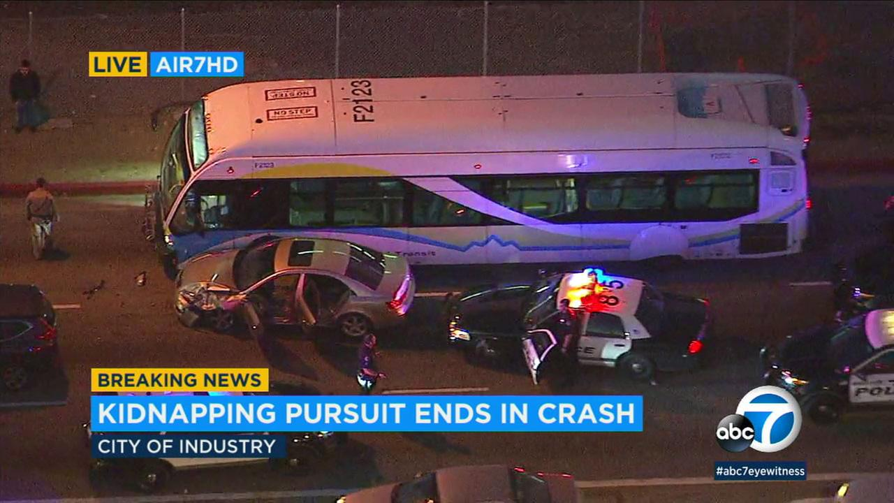 A woman led authorities on a high-speed chase with her children in her car, fleeing from Whittier until she crashed into a bus in Industry, officials said.