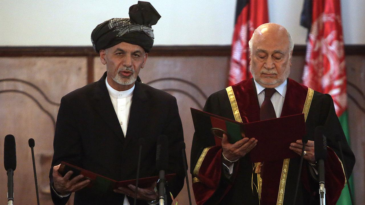 Afghan President Ashraf Ghani Ahmadzai, left, is sworn in by Chief Justice Abdul Salam Azimi, during his inauguration ceremony in Kabul, Afghanistan, Sept. 29, 2014.
