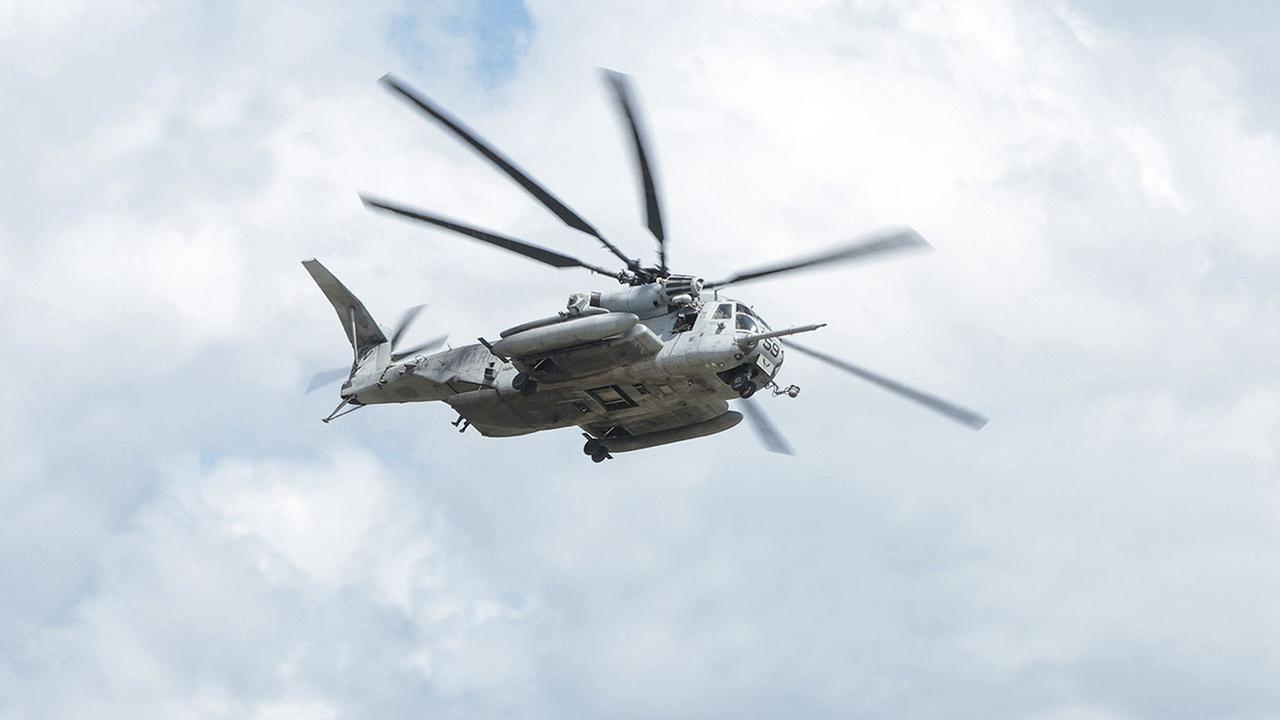 This 2017 file image shows a CH-53E Super Stallion helicopter flying over a Marine base in South Carolina.