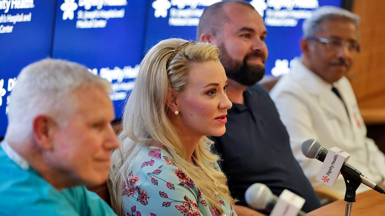 From left, Dr. John Elliott, Jamie Scott, Skyler Scott, and Dr. Vinit Manuel listen as Jamie Scott discusses the delivery of the couples quintuplets during a news conference.