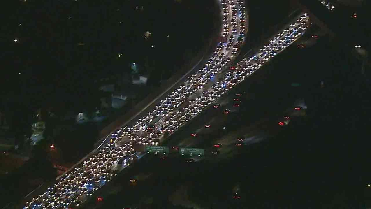 Traffic on the 101 Freeway was backed up for miles near Universal Studios in Studio City after a crash led to the discovery of a suspicious device Tuesday, Sept. 30, 2014.