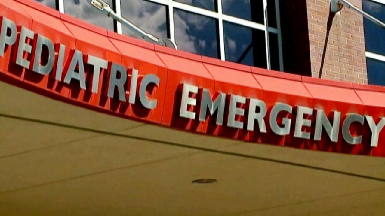 A sign shows the pediatric emergency wing at a hospital.
