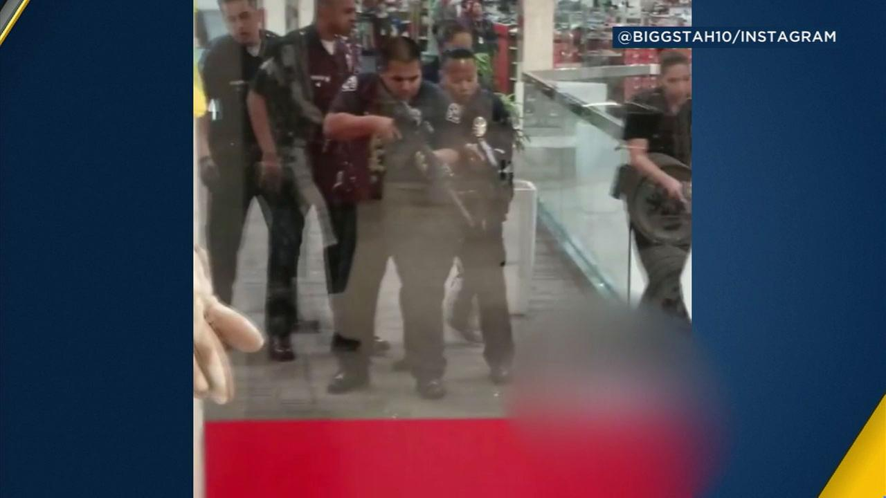 Officers confronted and shot a man with a knife at the Baldwin Hills Crenshaw Plaza.
