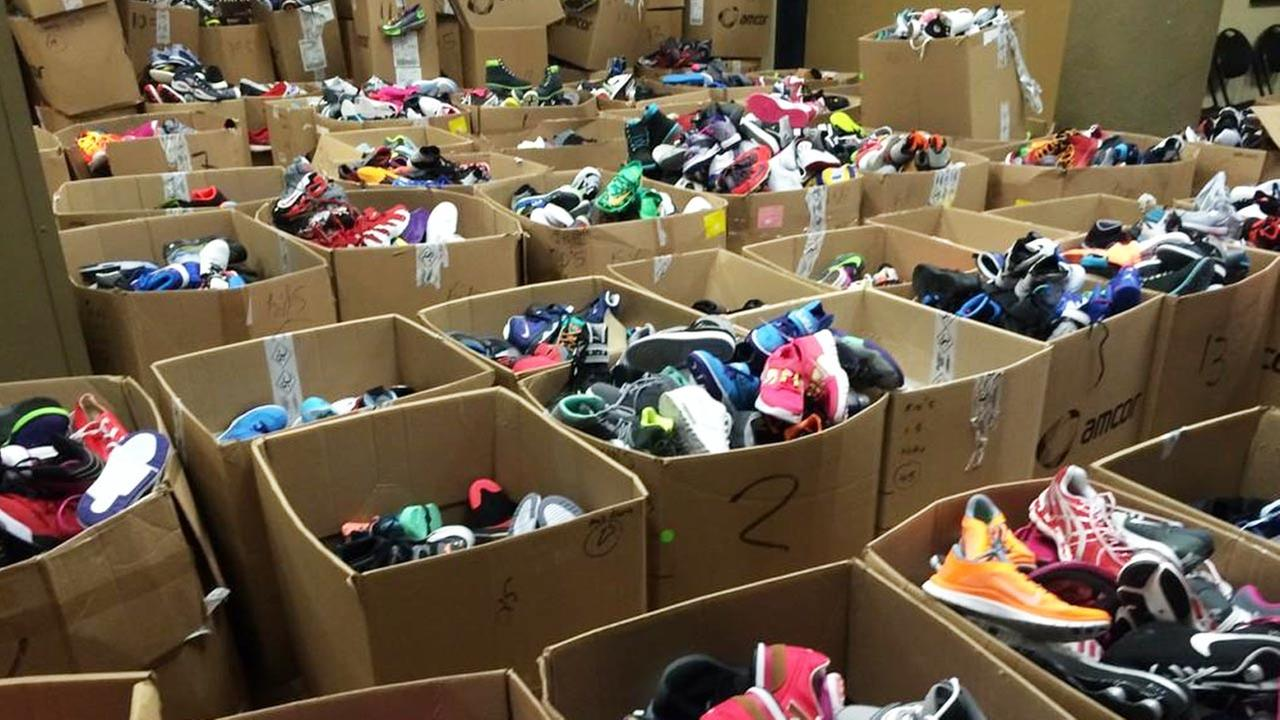 Boxes of shoes are shown at Fred Jordan Missions in downtown Los Angeles for the annual Back to School Giveaway on Thursday, Oct. 2, 2014.