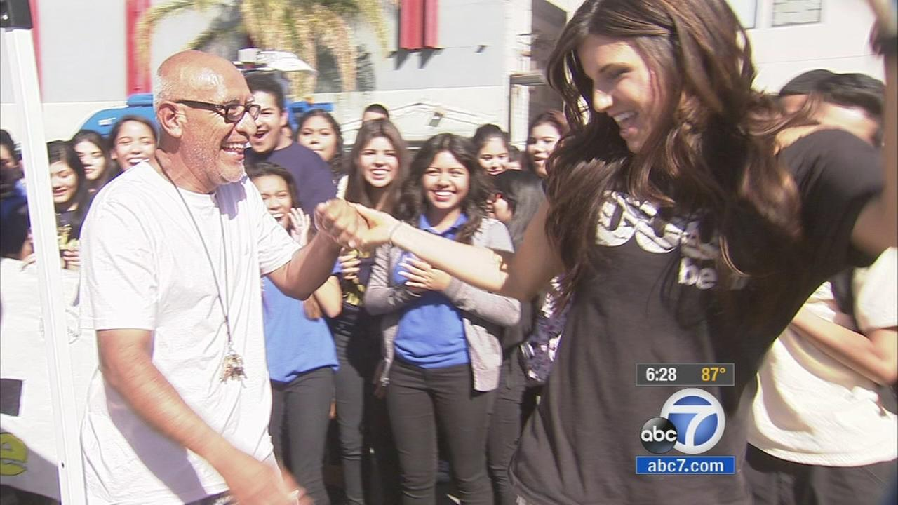 Students in East Los Angeles surprised their janitor with two Dodger tickets to the National League Division Series opener Friday, Oct. 3, 2014.