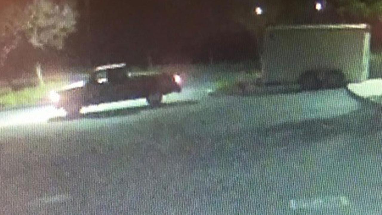 A surveillance photo shows a pickup truck hauling a stolen Future Farmers of America trailer that contained valuable items such as 8,000 Disneyland tickets.