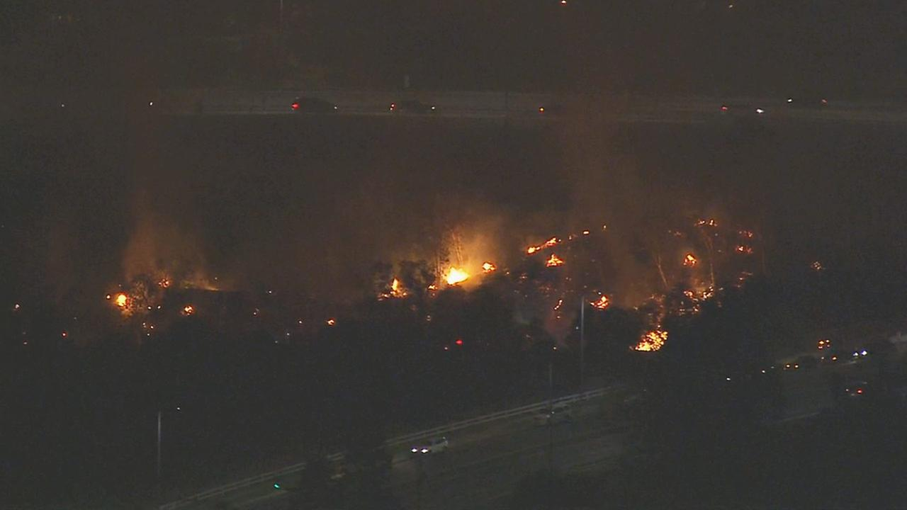 A brush fire was reported at Rinaldi Street just off the 118 Freeway in Porter Ranch Friday, Oct. 3, 2014.