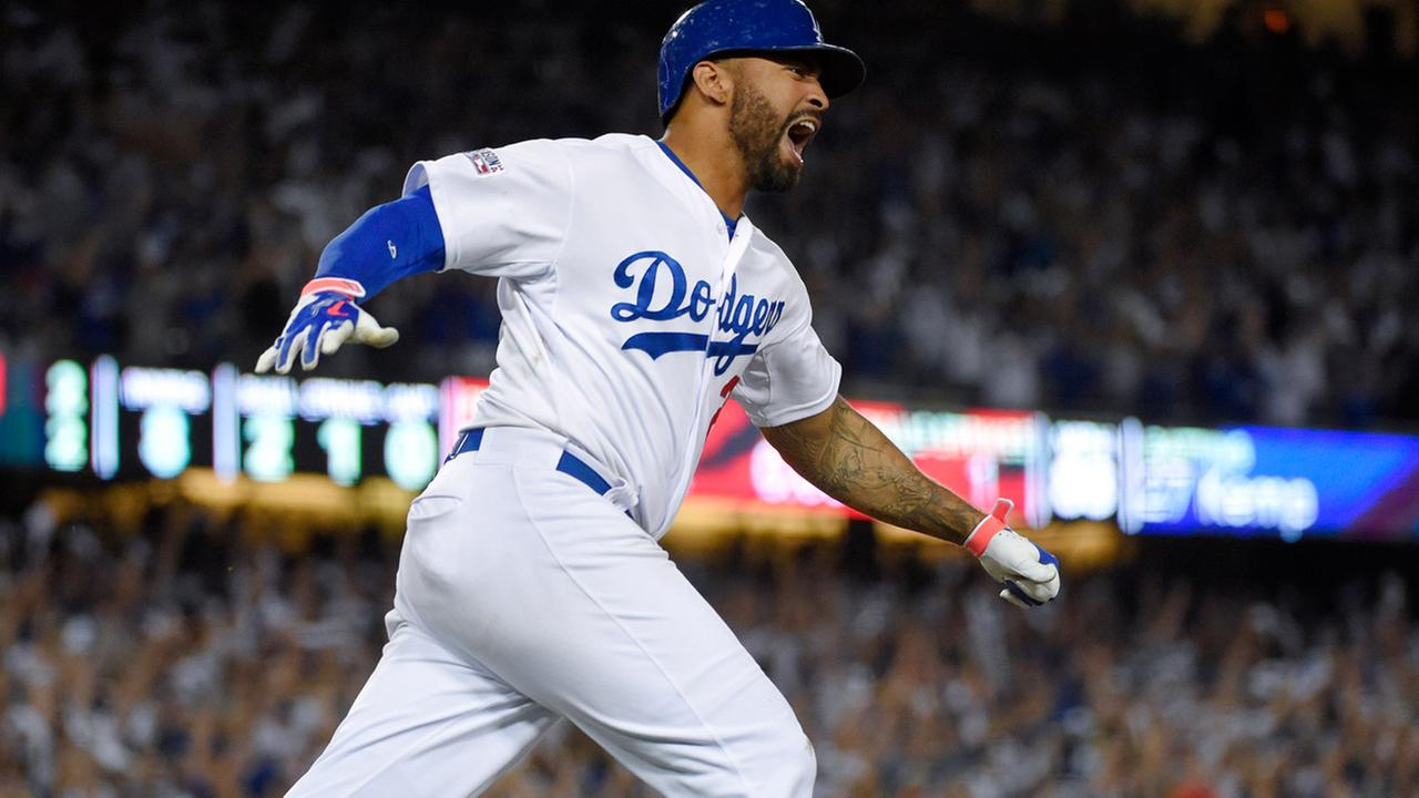 L.A. Dodgers Matt Kemp celebrates his home run against the St. Louis Cardinals in the eighth inning in Game 2 of the NL Division Series in L.A., Saturday, Oct. 4, 2014.