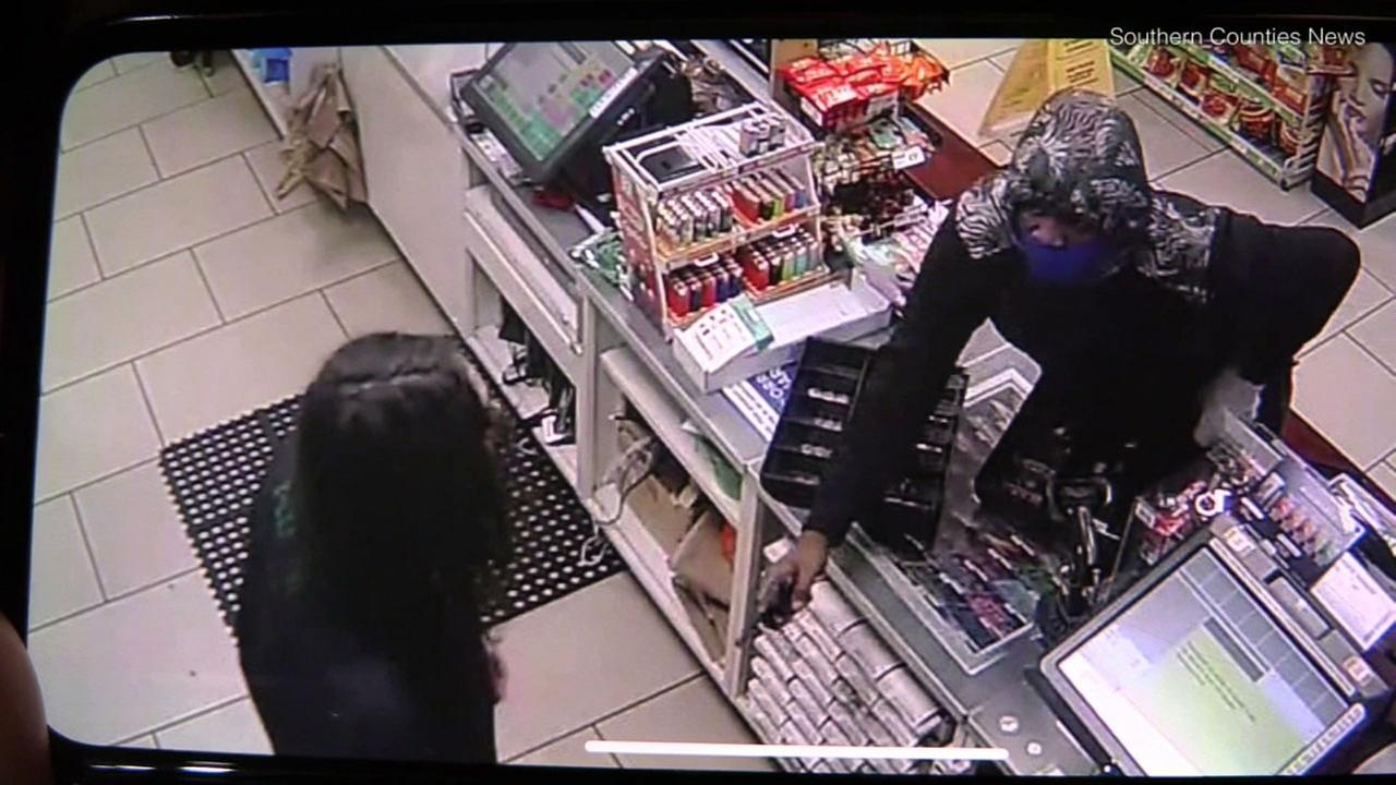 A suspect robs a convenience store at gunpoint in Cypress on Wednesday, April 25, 2018.