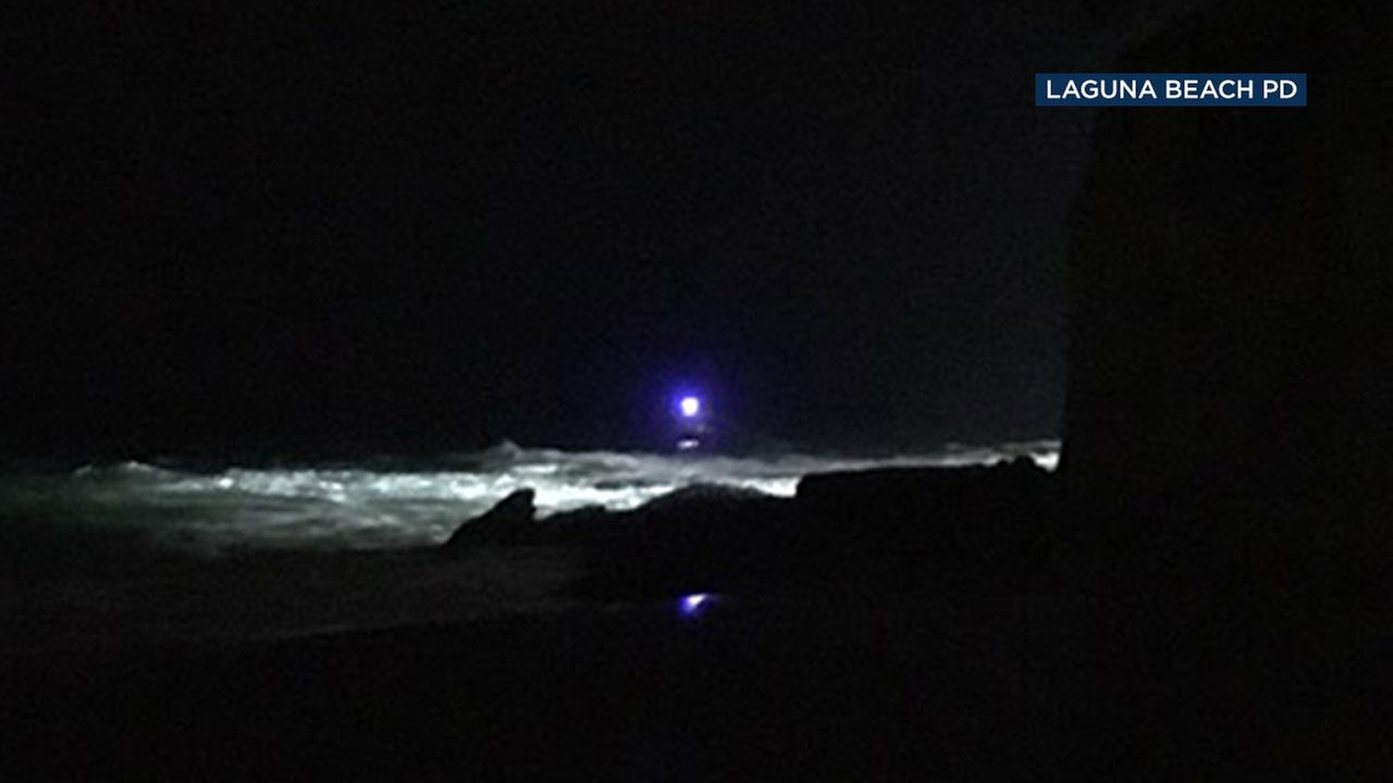 Rescue crews are searching the ocean near Laguna Beach where a woman was swept into the water and remains missing.
