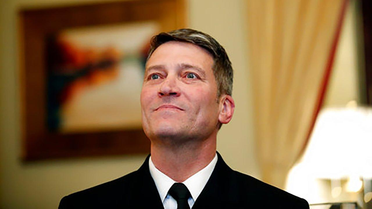 In this April 16, 2018, photo, U.S. Navy Rear Adm. Ronny Jackson, M.D., sits before their meeting on Capitol Hill in Washington.