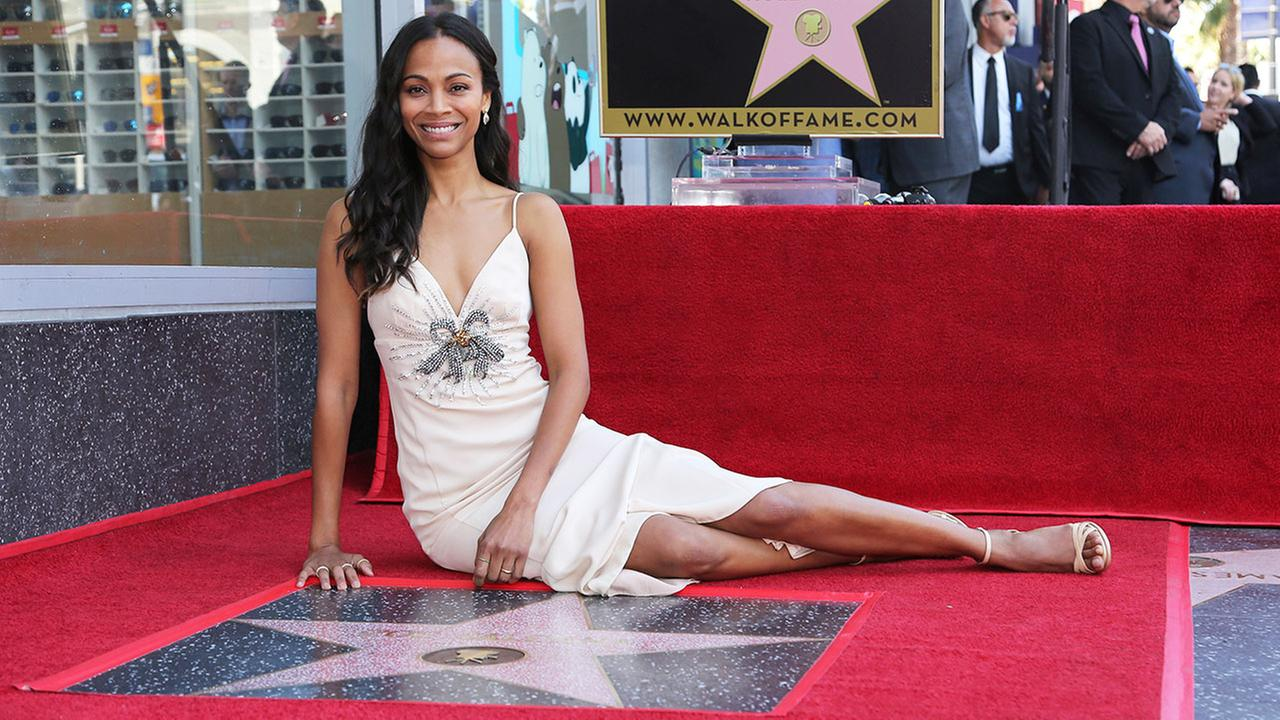 Zoe Saldana poses with her star at the ceremony honoring her with a star at the Hollywood Walk of Fame on Thursday, May 3, 2018, in Los Angeles.