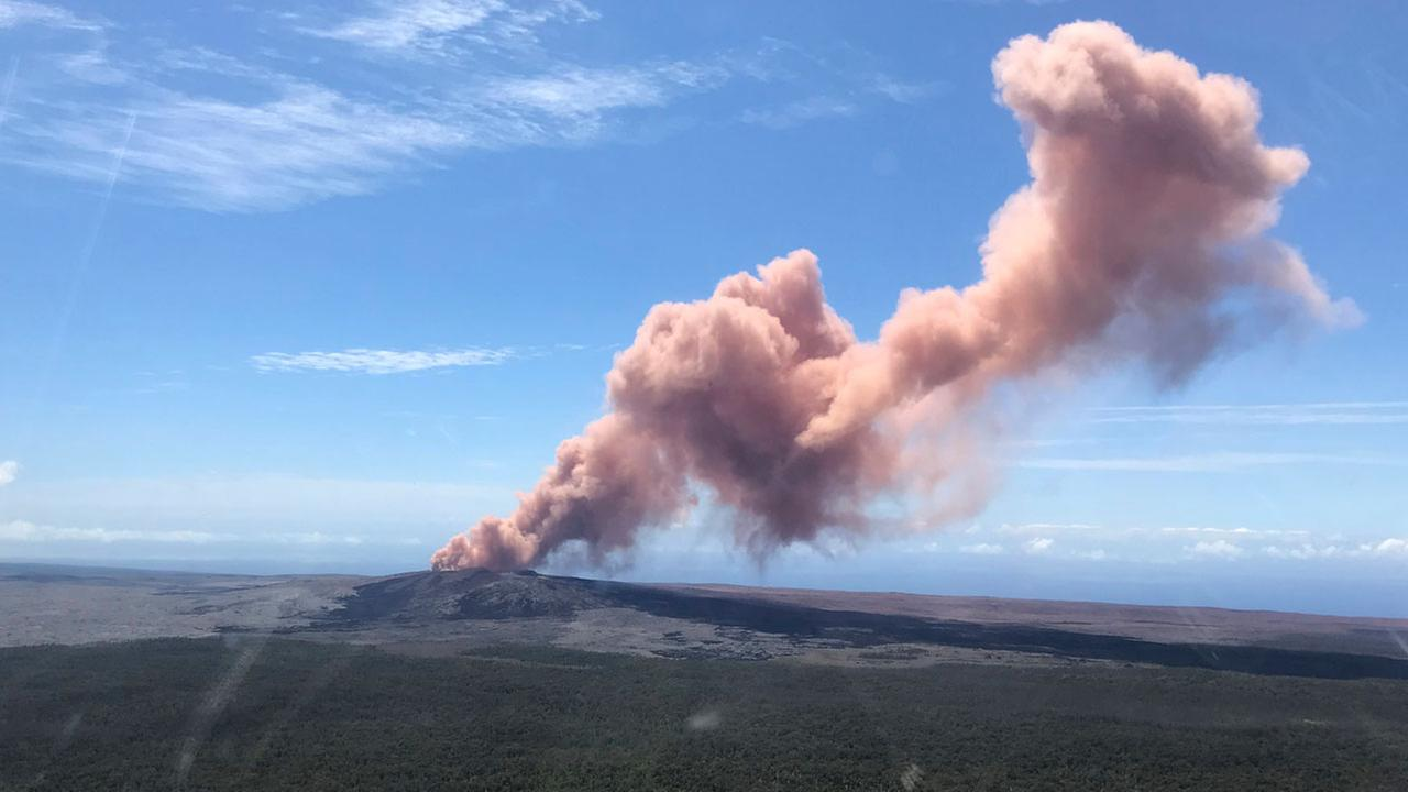 In this photo provided by the U.S. Geological Survey, red ash rises from the Puu Oo vent on Hawaiis Kilauea Volcano after a magnitude-5.0 earthquake struck the Big Island.