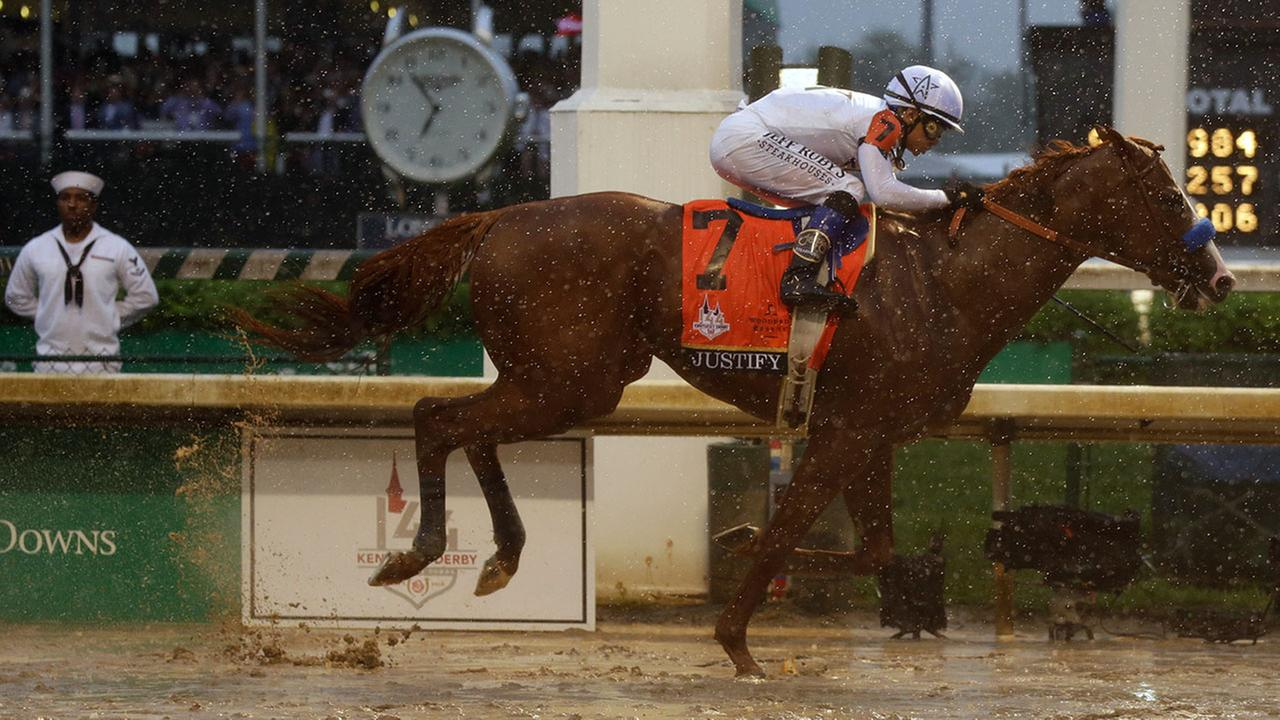 Mike Smith rides Justify to victory during the 144th running of the Kentucky Derby horse race at Churchill Downs Saturday, May 5, 2018, in Louisville, Ky.