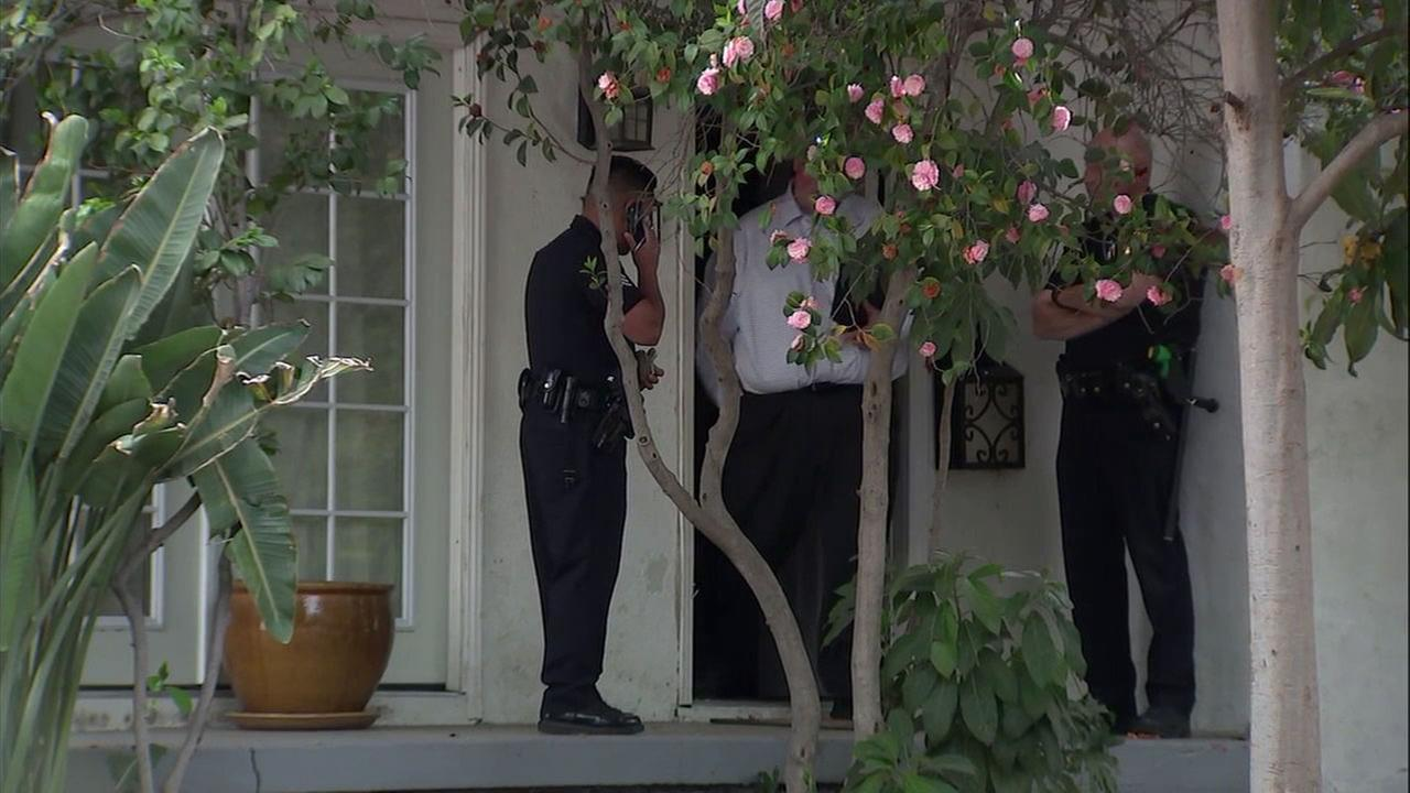 LAPD officers were investigating the mauling of a baby by a dog in Sherman Oaks.