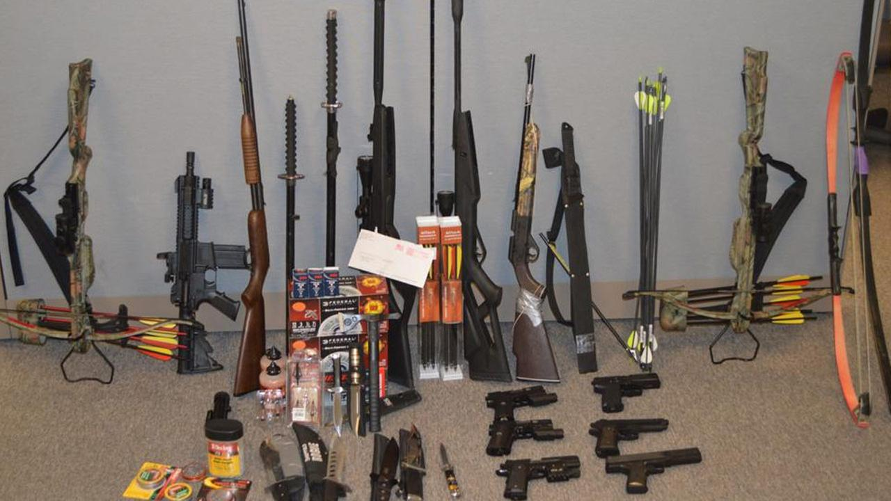 Deputies found a stash of weapons, including a rifle, ammunition, large hunting knives and cross bows, during a search of a Black Rock High School students house.