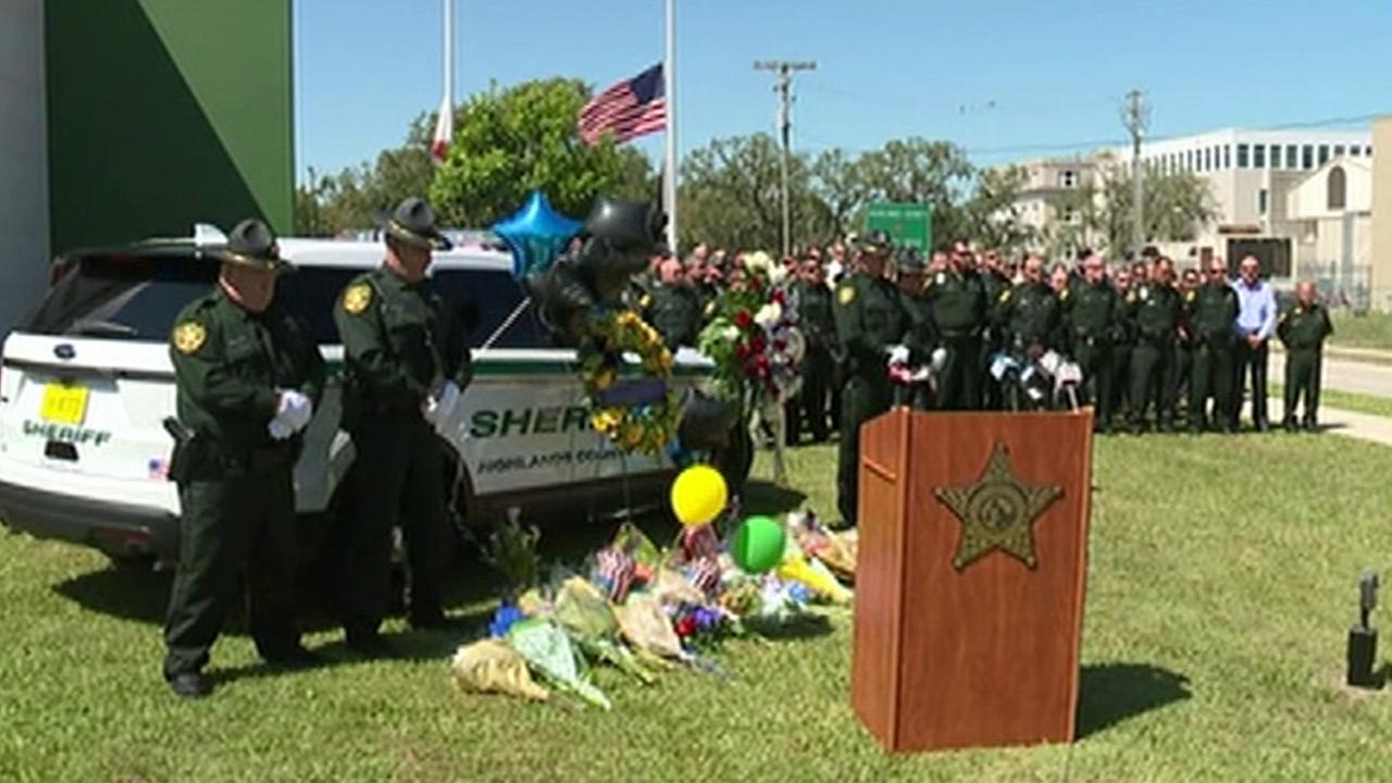 A Florida sheriffs deputy died Monday afternoon, a day after being shot in the head while responding to a dispute over a cat, authorities said.