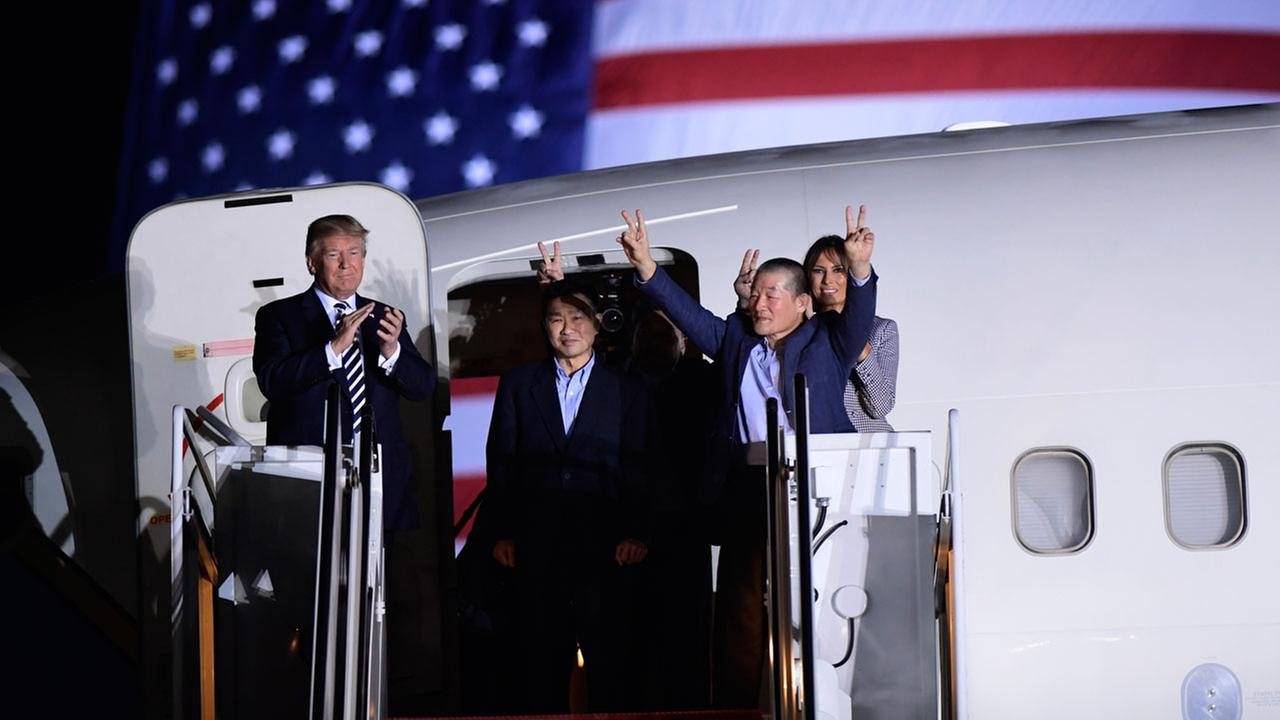 President Donald Trump greets Tony Kim, Kim Hak Song and Kim Dong Chul, who were detained in North Korea for more than a year, as they arrive at Andrews Air Force Base.