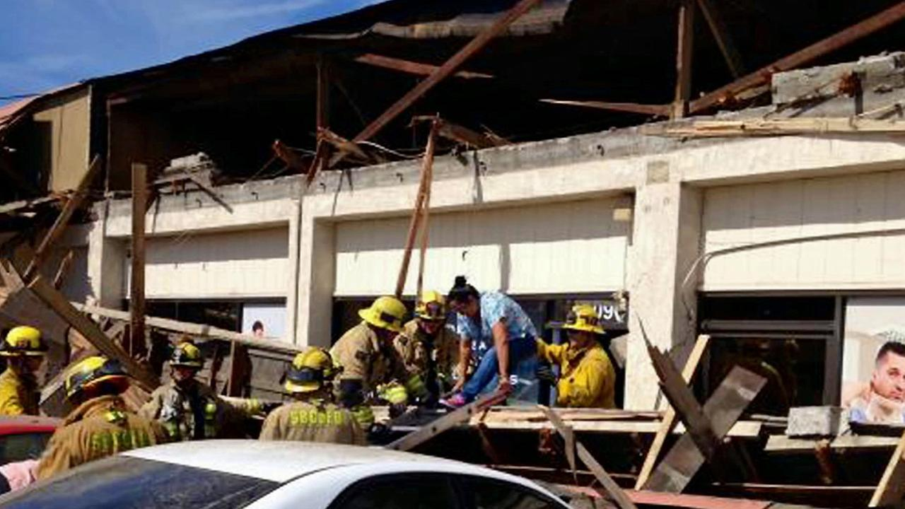 A person is rescued after being stuck in rubble from a partial roof collapse at a Fontana strip mall on Friday, Oct. 10, 2014.