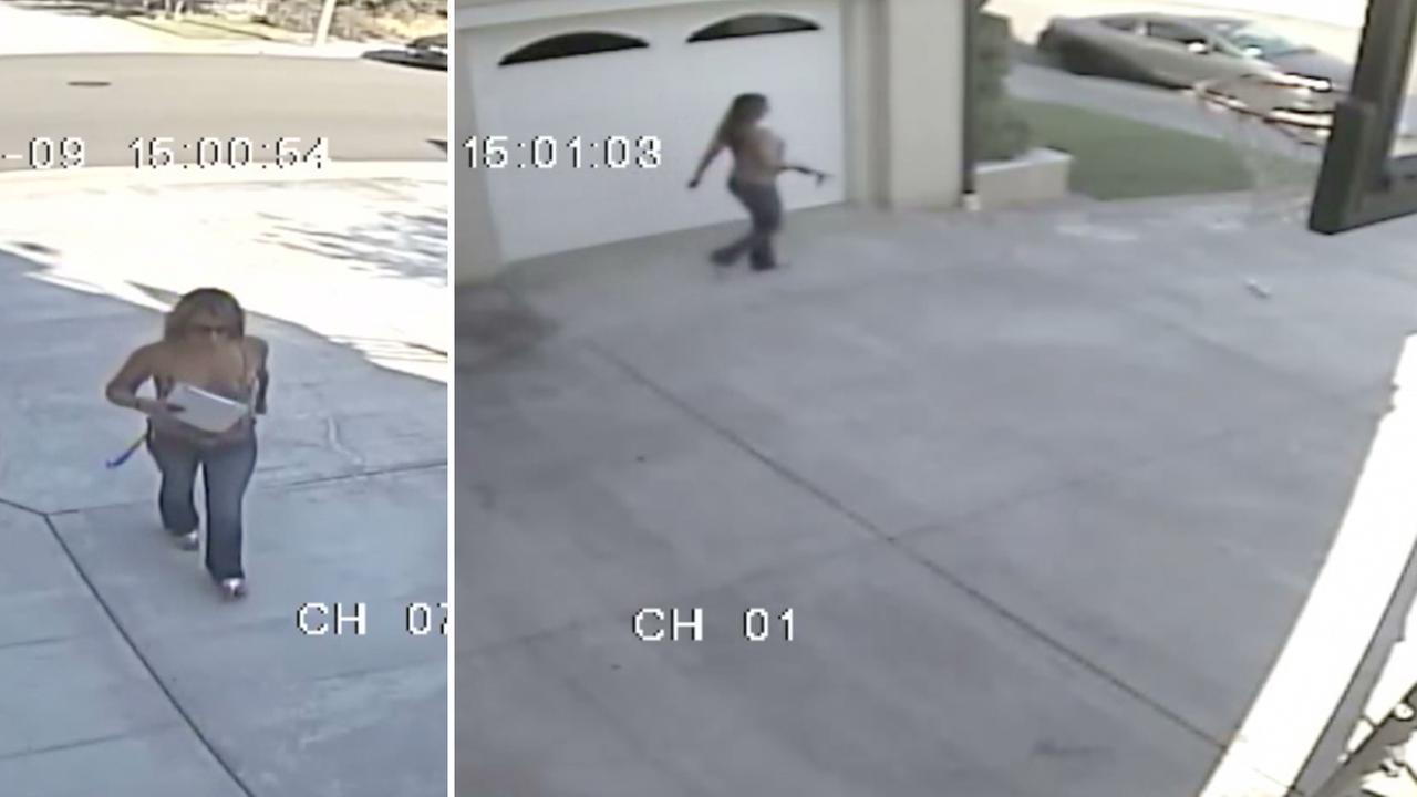Surveillance video shows a woman walking up to a house and allegedly stealing an envelope delivered to a home in Yorba Linda on Thursday, Oct. 9, 2014.
