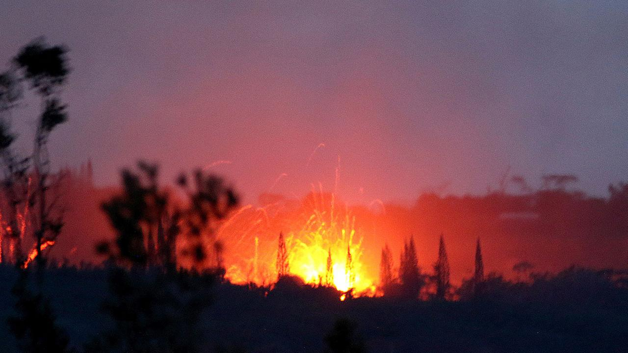 Lava shoots into the night sky from active fissures on the lower east rift of the Kilauea volcano, Tuesday, May 15, 2018, near Pahoa, Hawaii.