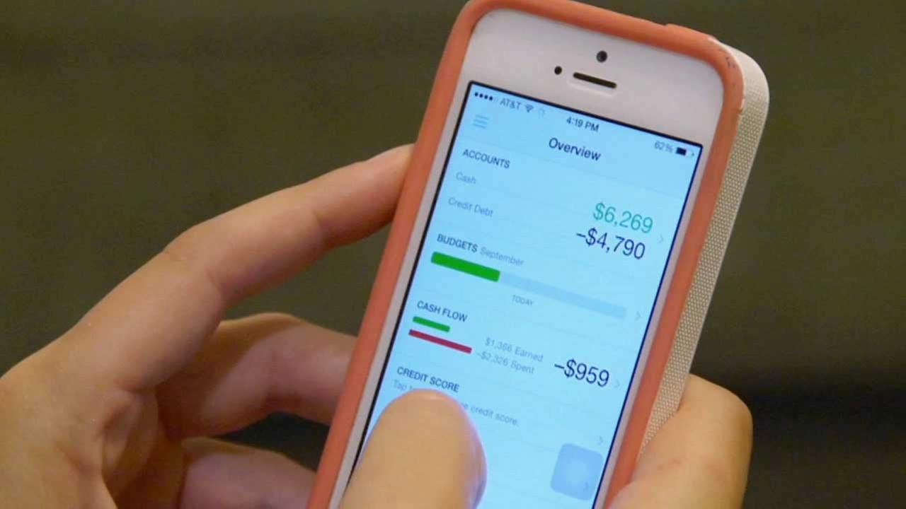 Ashley Bona uses one of her financial management apps on her mobile device as a way to track her spending habits.