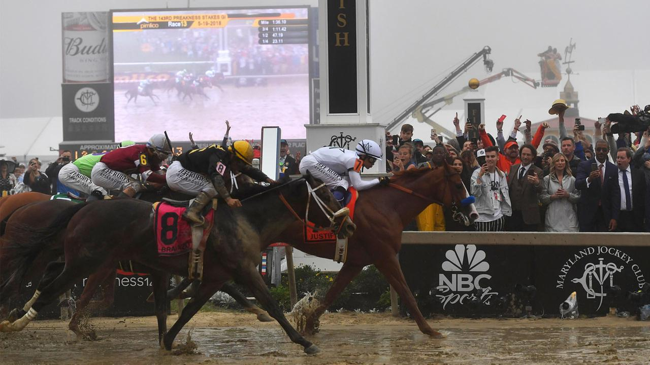 Justify with Mike Smith atop wins the 143rd Preakness Stakes horse race at Pimlico race track, Saturday, May 19, 2018.