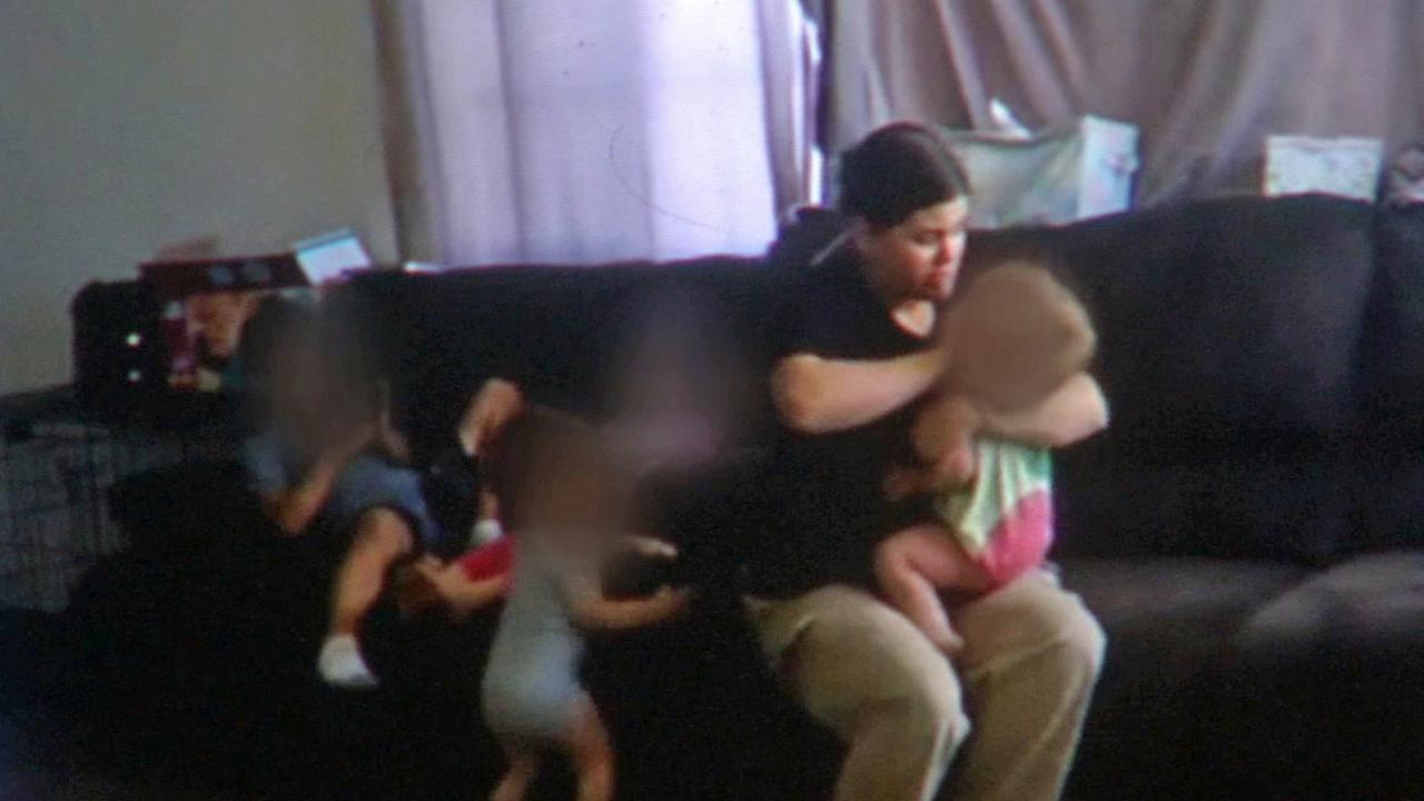 A still from a nanny cam shows a nanny abusing a child.