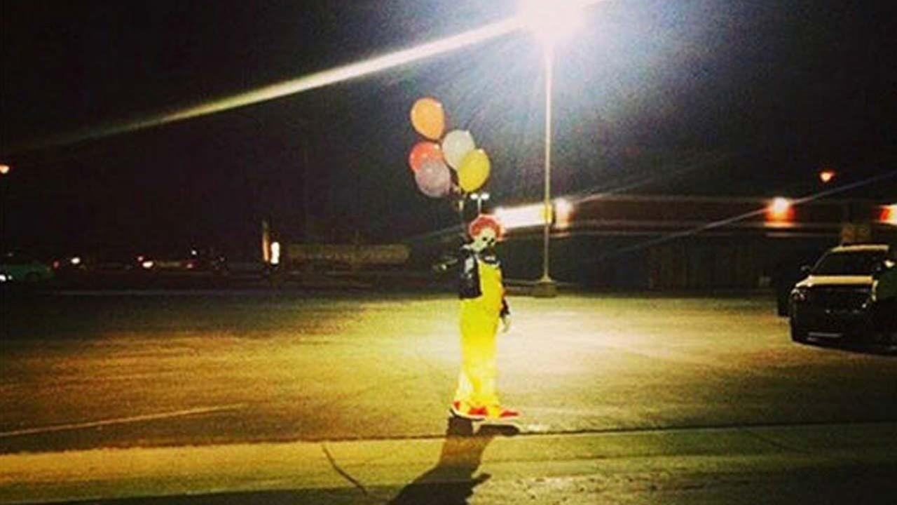 This Instagram photo posted by @WascoClown shows a clown posing for a photo with balloons.