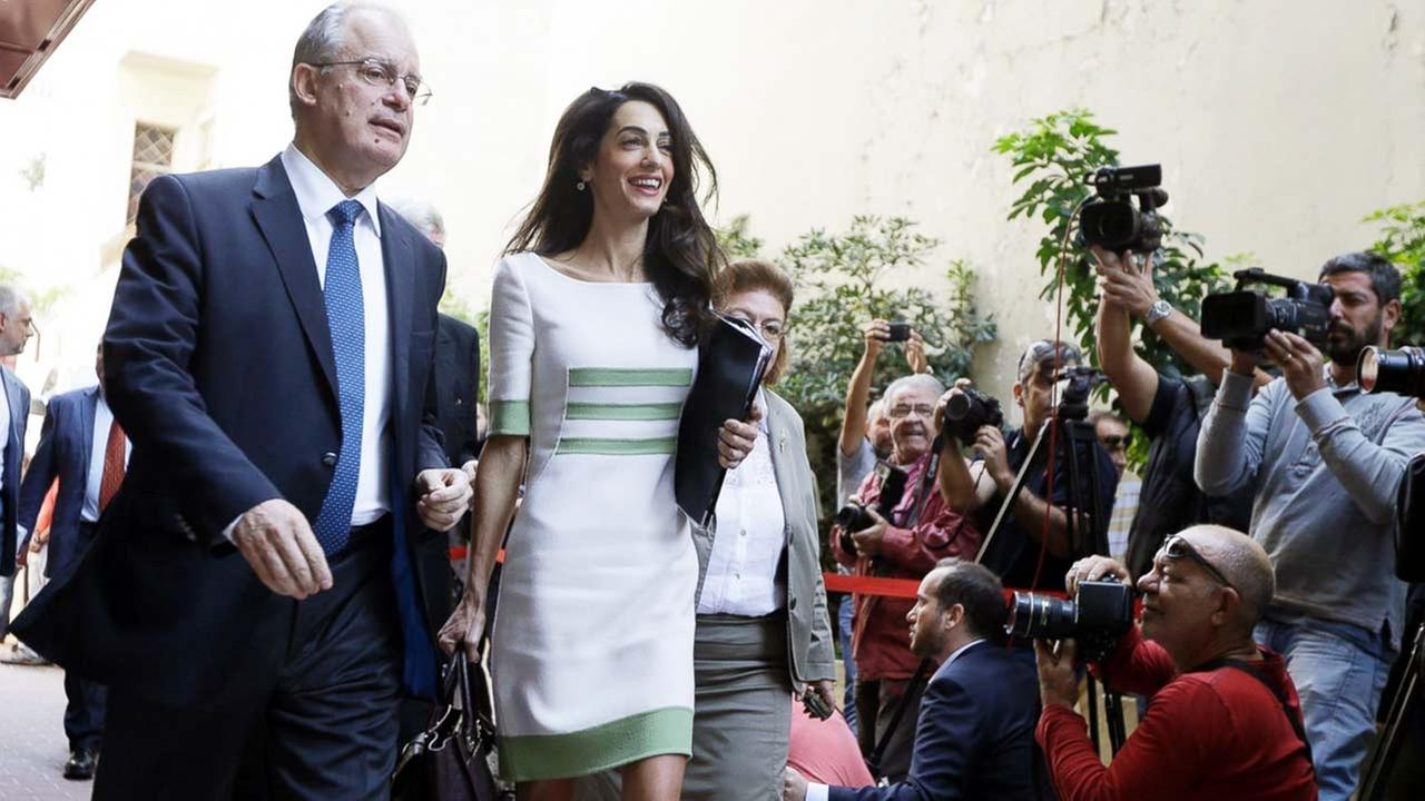 Members of the media take photographs of Greek Culture Minister Kostas Tassoulas, left, and lawyer Amal Clooney, after their meeting, in Athens, Tuesday, Oct. 14, 2014.