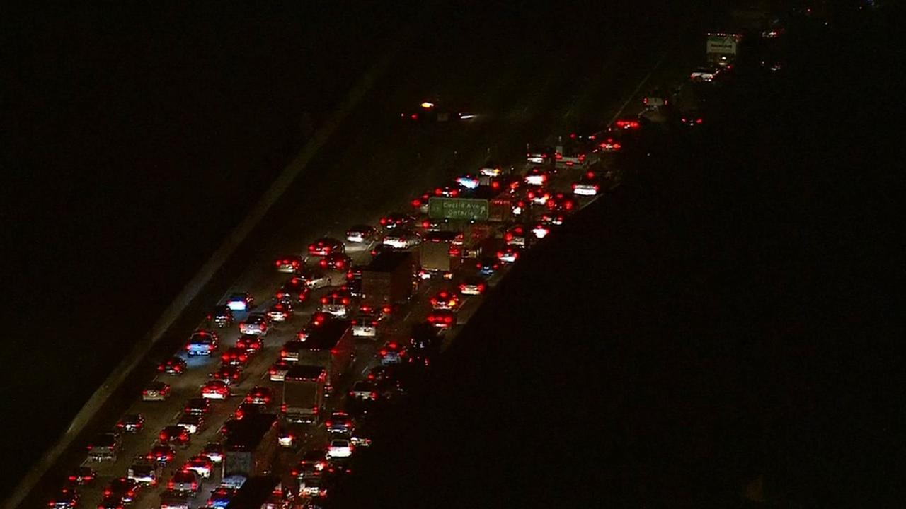 Traffic was blocked in both directions on the 60 Freeway in Ontario while authorities dealt with a suicidal man on Tuesday, Oct. 14, 2014.