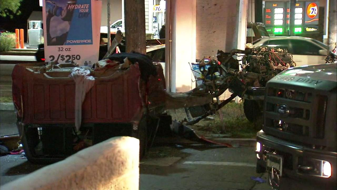 A pickup truck is shown mangled and split in half after a single-car crash in Chatsworth.
