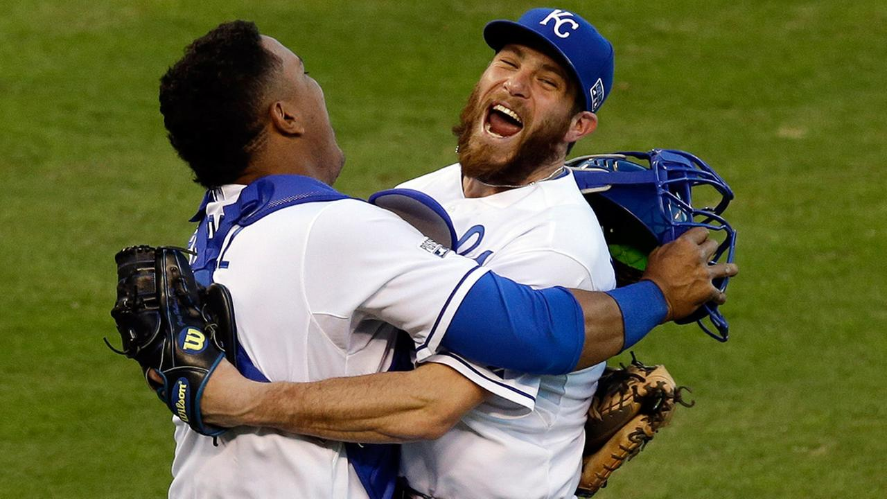 Kansas City Royals relief pitcher Greg Holland and catcher Salvador Perez celebrate after defeating the Baltimore Orioles in Game 4 of the ALCS on Wednesday, Oct. 15, 2014.