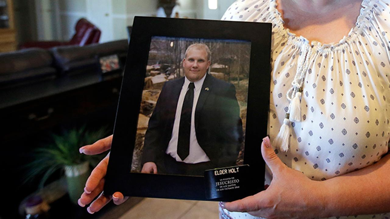 Laurie Holt holds a photograph of her son Josh Holt at her home, in Riverton, Utah. Josh Holt, a 24-year-old American man jailed in Venezuela.