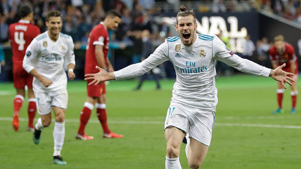Real Madrids Gareth Bale celebrates after scoring his sides second goal during the Champions League Final soccer match between Real Madrid and Liverpool at Olimpiyskiy Stadium.