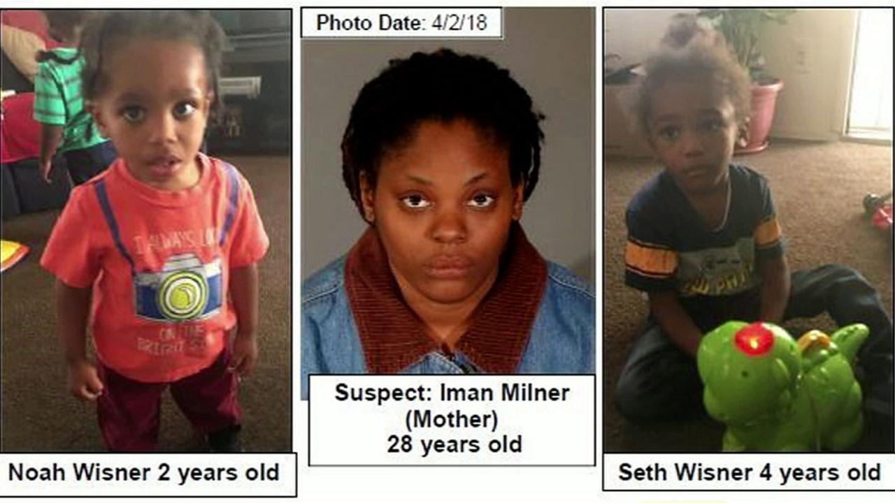 A photo shows Iman Milner (center), accused of possibly abducting her two young boys on Tuesday, May 29, 2018.