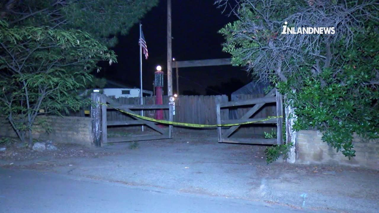 Crime scene tape ropes off a property in Yucaipa, where two bodies were discovered by sheriffs deputies on Wednesday, May 30, 2018.