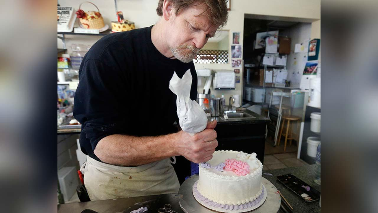 In this March 10, 2014, file photo, Masterpiece Cakeshop owner Jack Phillips decorates a cake inside his store in Lakewood, Colorado.
