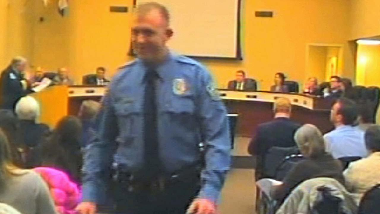 In this Feb. 11, 2014 file image from video released by the City of Ferguson, Mo., officer Darren Wilson attends a city council meeting in Ferguson.