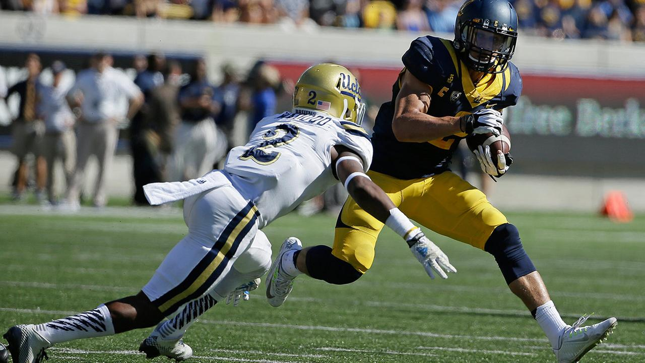 California running back Daniel Lasco, right, runs with the ball around UCLA defensive back Jaleel Wadood, left, during NCAA college football game Saturday, Oct. 18, 2014.